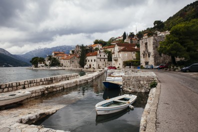 boat docked in perast montenegro by alli campbell photography